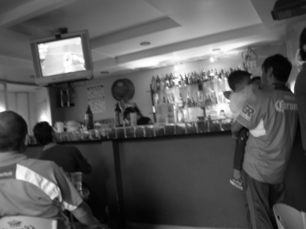 Father and son watching the football match.